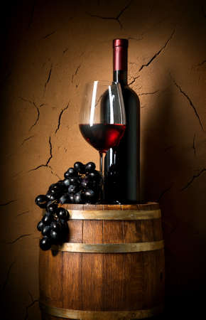 Photo pour Wine on barrel in cellar with clay wall - image libre de droit