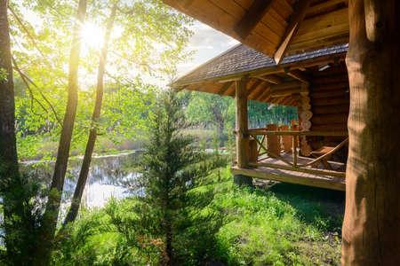Photo pour Wooden house and river - image libre de droit