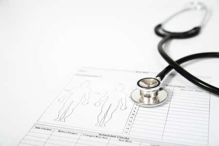 Foto de Stethoscope on a medical form. Healthcare concept - Imagen libre de derechos