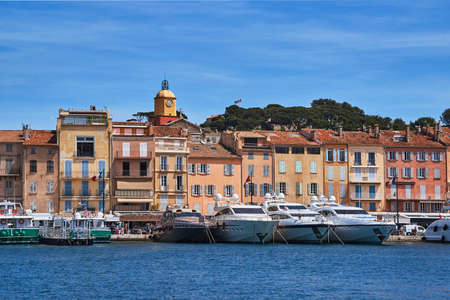 Photo for Sailboats and yachts moored to the quay port of Saint-Tropez, France - Royalty Free Image