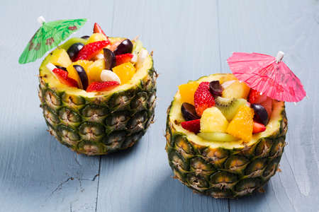 Photo for Fresh fruit salad served in bowls with fresh pineapple - Royalty Free Image