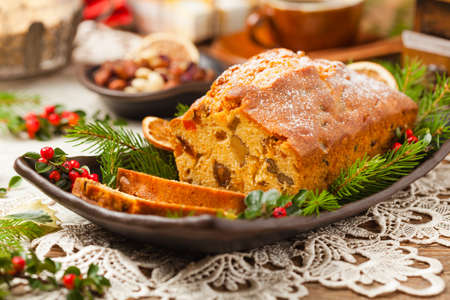 Photo pour Christmas cake. Fruitcake. Natural wooden background. Top view. - image libre de droit