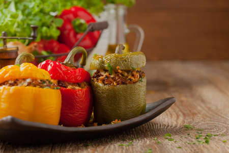 Photo pour Colorful baked with cheese, stuffed peppers with rice and minced meat. - image libre de droit