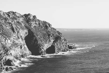 Photo for Rocky coast of Atlantic ocean in Portugal. Breathtaking landscape and nature of the the Portuguese coastline. Black and white photo - Royalty Free Image