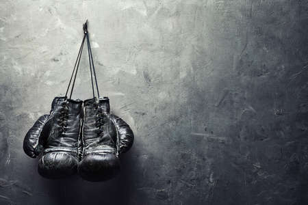 Photo for old boxing gloves hang on nail on texture wall with copy space for text  Retirement concept - Royalty Free Image