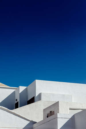 Photo pour Abstract fragment of white architecture house in Lanzarote. Traditional building exterior. background - image libre de droit