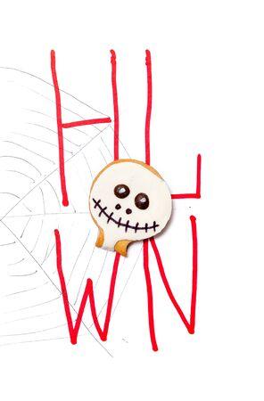 Foto de Original poster for Halloween. A round mask in the form of a mask lies on a close-up drawn web. Drawn red consonants H L W N - Imagen libre de derechos