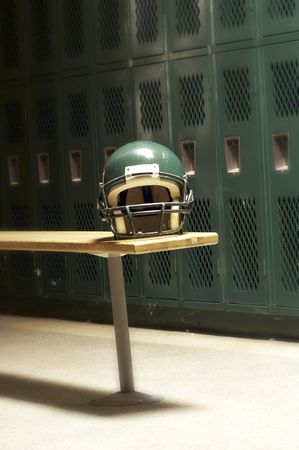 a football helmet on bench in locker room mural