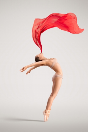 Photo for The lovely photo of a girl dancing with red cloth  - Royalty Free Image