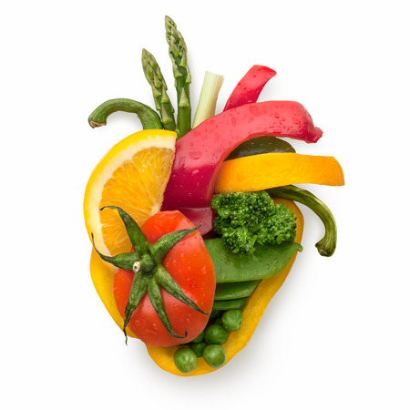 Foto de A healthy human heart made of fruits and vegetables as a food concept of smart eating. - Imagen libre de derechos