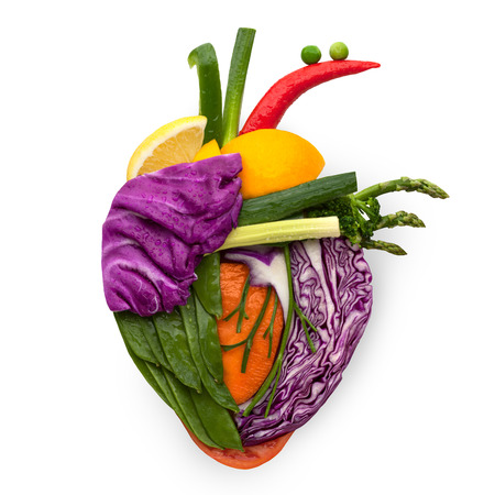 Photo pour A healthy human heart made of fruits and vegetables as a food concept of smart eating. - image libre de droit