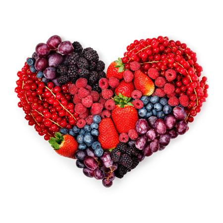 Photo pour A variety of summer berries in the shape of heart as a symbol of valentine and love. - image libre de droit