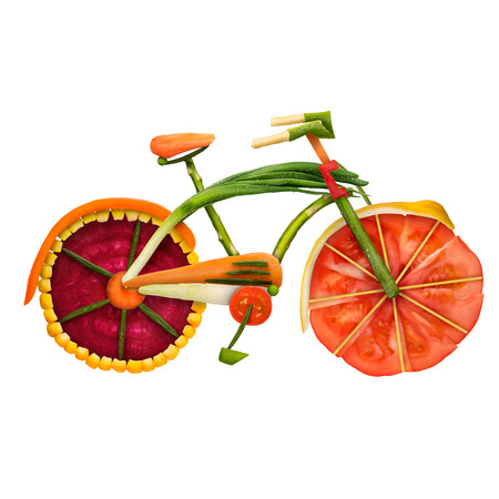Photo for Healthy food concept of an urban fixed gear bicycle in detail made of fresh vegetables full of vitamins, isolated on white background. - Royalty Free Image
