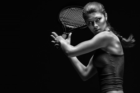 Photo pour A portrait of a tennis player with a racket. - image libre de droit