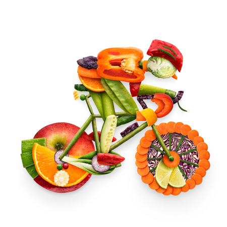 Foto de Healthy food concept of a cyclist riding a bike made of fresh vegetables and fruits, isolated on white. - Imagen libre de derechos
