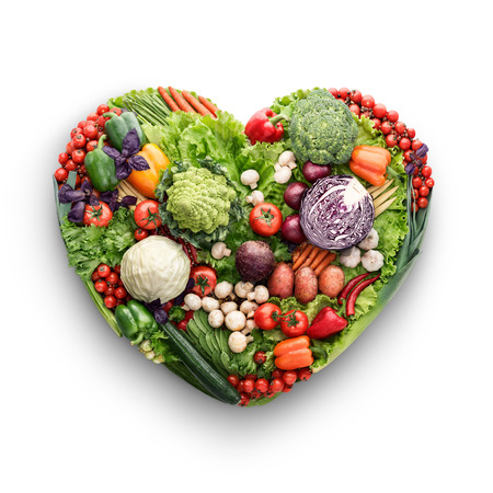 Photo pour Healthy food concept of a human heart made of vegetable and fruit mix that reduce death risk, isolated on white. - image libre de droit