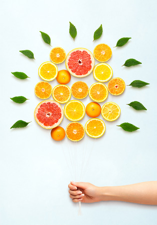 Photo for Healthy food concept and creative still life of bouquet made of fresh citrus fruits. - Royalty Free Image