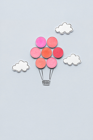 Photo pour Creative concept photo of aerostat made of cosmetics on grey background. - image libre de droit