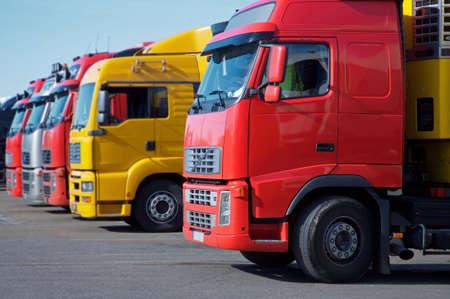 yellow and red semi trucks