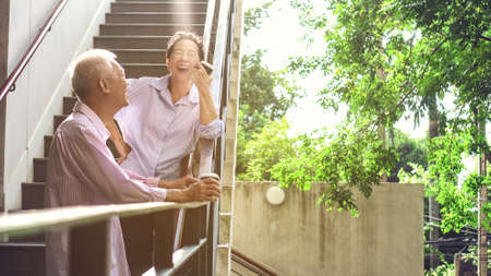 Foto de Asian elderly professional couple talking outdoor morning in modern building - Imagen libre de derechos