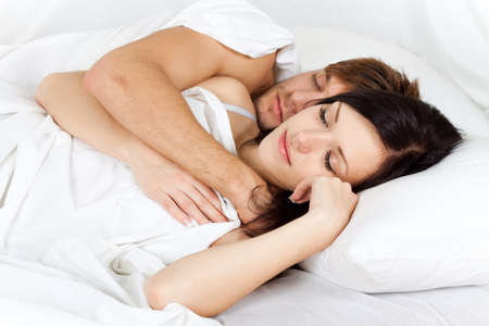Photo pour young lovely couple lying in a bed, happy sleep - image libre de droit