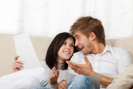 Photo for beautiful young couple sitting on a sofa - Royalty Free Image