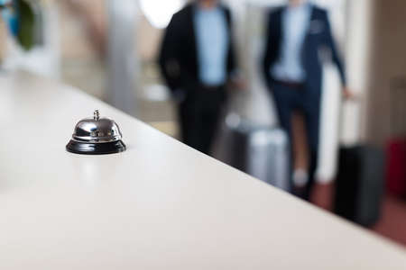 Photo for Desk With Bell Modern Luxury Hotel Reception Counter Regstration Workplace - Royalty Free Image
