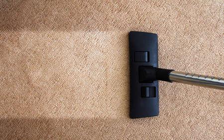 Photo pour closeup of the vacuum on the carpet - image libre de droit