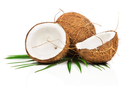 Photo for Coconut with green leaves on white background - Royalty Free Image