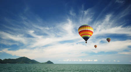 Photo for Beautiful hot air balloon over cloudy blue sky - Royalty Free Image