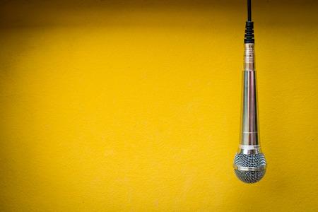 Photo pour close up microphone on yellow background - image libre de droit