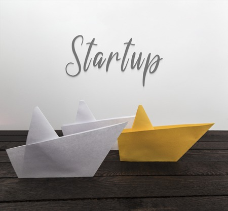 Photo for Start-up concept. Paper boats on wood with inscription: Comfort zone. Horizontal view. - Royalty Free Image