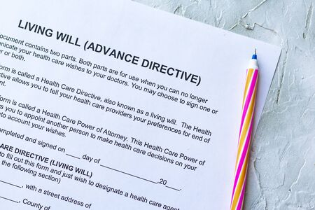 Photo pour Filling Living Will Advance Directive form. Top view - image libre de droit