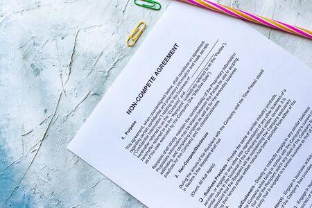 Photo pour Filling Non-Compete Agreement Form. View from above - image libre de droit