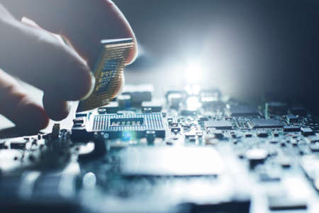 Photo pour Electronic engineer of computer technology. Maintenance computer cpu hardware upgrade of motherboard component. Pc repair, technician and industry support concept. - image libre de droit