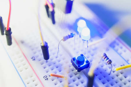 Photo for details of breadboard for modern robotics. Microcontroller components. - Royalty Free Image