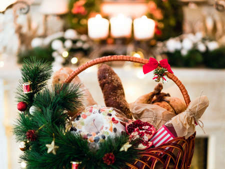 Photo for Christmas goods in a basket. Festive holiday food gift concept - Royalty Free Image