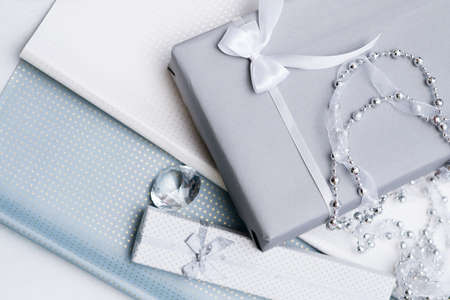 Photo pour luxury jewelry gifts for top class on grey background. professional present wrapping for toffs on birthday, new year, christmas, thanksgiving, valentines day and other holidays. - image libre de droit