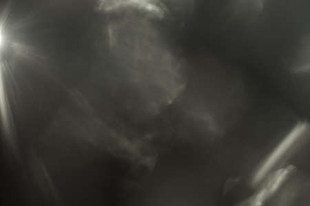 Photo pour Real Lens flare light effect. Sparkle ray leak on black background. Optical effect of spotlight. Flash leak beam. - image libre de droit
