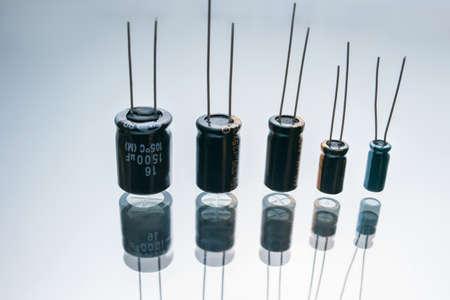 Foto de Bipolar electric capacitors on white background. microelectronic component. construction of two electrodes - Imagen libre de derechos