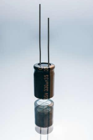 Foto de Bipolar electric capacitor on white background. microelectronic component. construction of two electrodes - Imagen libre de derechos