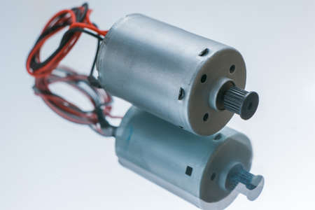 Foto de Cylindrical electrical motor on white background. conversion of electrical energy into mechanical - Imagen libre de derechos