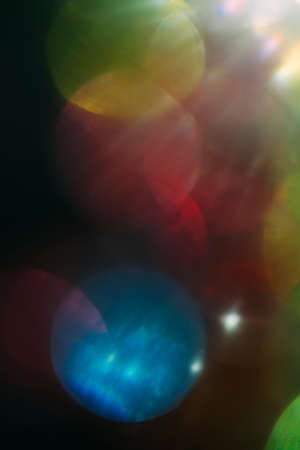 Foto per Lens flare. colorful abstract. bokeh light on black background. ray leak - Immagine Royalty Free
