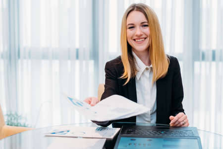 Foto de job interview. employment and career concept. business woman holding a resume or an application form. friendly recruiter in office workspace. - Imagen libre de derechos