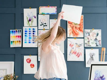 Photo pour crafty room. artful studio. creative painter workspace. paintings watercolor drawings on the wall. artist dancing - image libre de droit