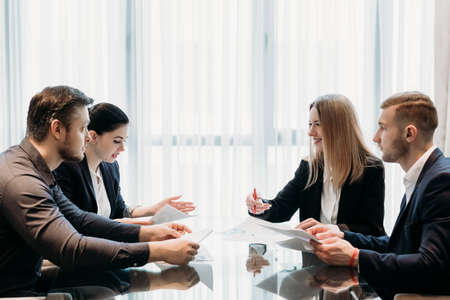 Photo for business team communication. partners negotiation. men and women discussing affairs in office workspace - Royalty Free Image