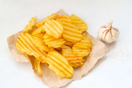 Photo pour junk fast food and unhealthy eating. crispy chips. crunchy potato crisps on white background - image libre de droit