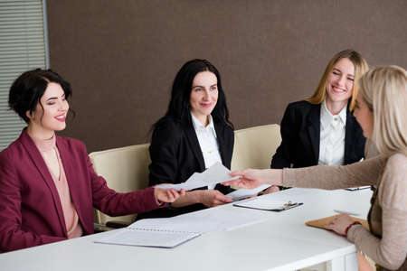 Photo for job hiring. women from hr team smiling to a young work applicant. successful recruitment interview - Royalty Free Image