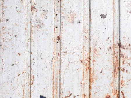 Foto de rusty metal distressed background. scratched profiled sheet. grunge old weathered backdrop. iron texture. copyspace concept - Imagen libre de derechos