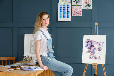 Photo pour creative leisure. painting hobby. artful personality. talented girl sitting near a finished drawing - image libre de droit